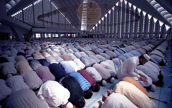 Men attend Friday prayers in Faisal mosque, Islamabad during Ramazan. - Photo by AP.