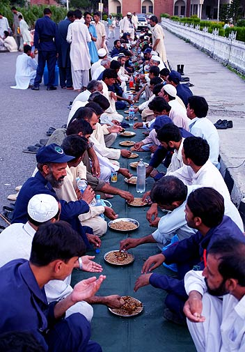 People break their fast in Islamabad on Thursday. - Photo by AP.