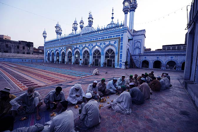 Pakistani Muslims break their fast at a mosque in Rawalpindi on Wednesday. - Photo by AFP.