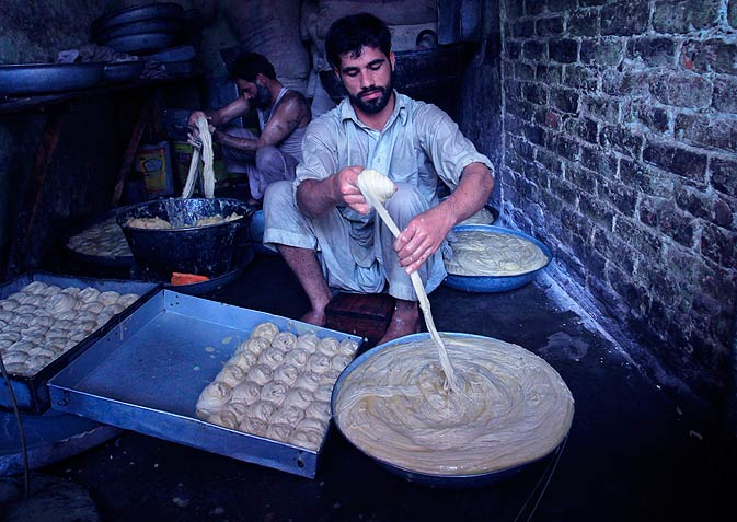 A man prepares vermicelli, a specialty eaten during the Muslim fasting month of Ramazan, ahead of Iftar on Monday the 15th. - Photo by Reuters.