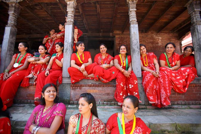 Women rest at the premises of Pashupatinath Temple.