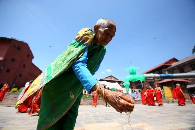 A woman washes her hand during the festival.
