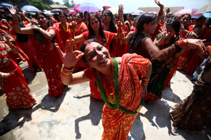 Women sing and dance during the festival.