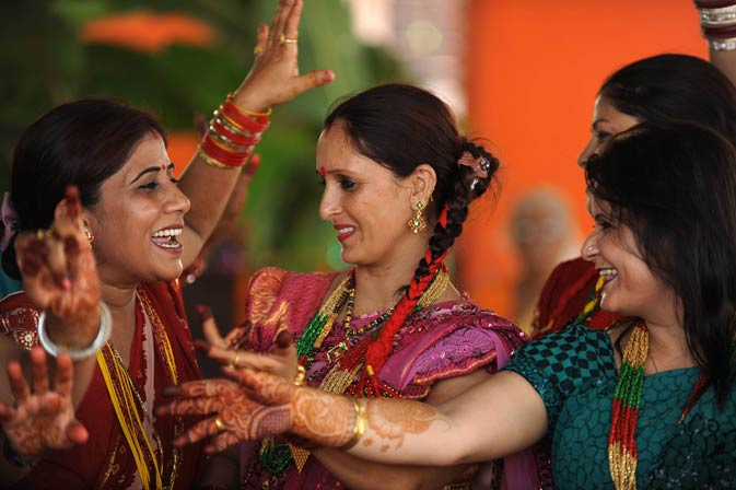 Indian Hindu women dance after offering prayers to the Hindu god of destruction Lord Shiva during the festival in Siliguri on August 31, 2011.