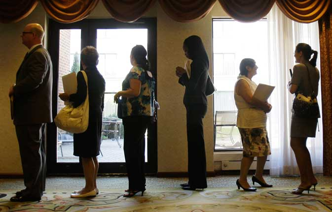 In this Aug. 16, 2011 photo, job seekers stand in line to enter a job fair, in Independence, Ohio.  The number of people applying for unemployment benefits rose back above 400,000 last week. Still, the average number of applications over the past four weeks fell to its lowest level since mid-April. That suggests the job market may be improving.
