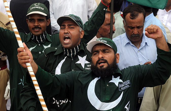 Pakistanis shout pro-Pakistani slogans during a ceremony in Lahore.
