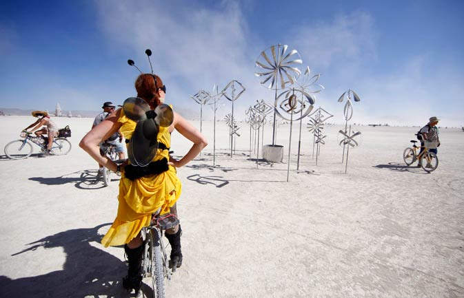 A participant looks at an art installation during the Burning Man 2011 ?Rites of Passage? arts and music festival in the Black Rock desert of Nevada, August 31, 2011.