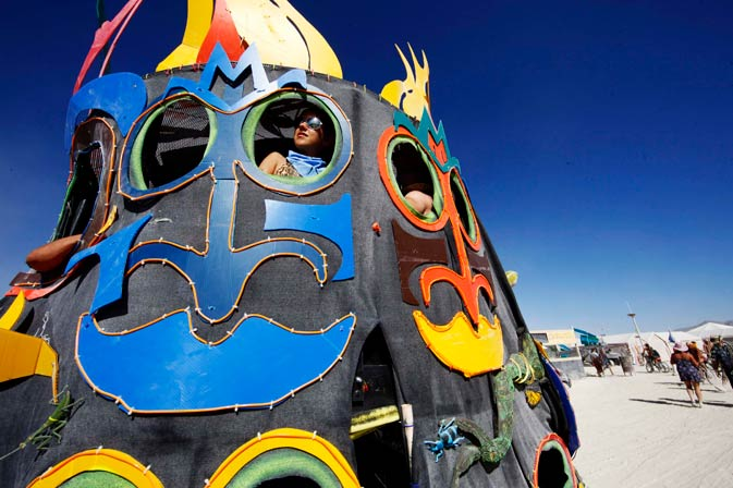 Participants ride in an art car during the festival.