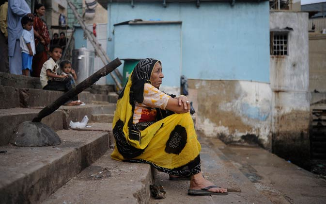 A woman sits alone while waiting for the celebrations.