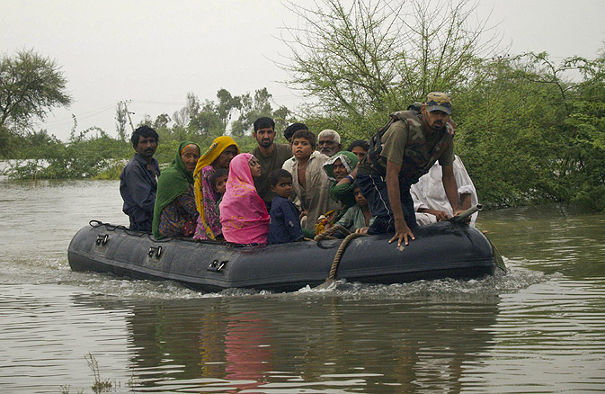 Troops rescue villagers displaced by floods due to heavy monsoon rains over a few days in Pangario.