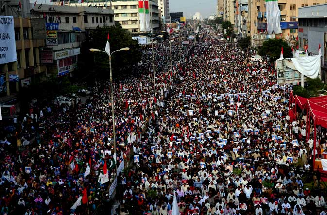 Activists of Muttahida Qaumi Movement (MQM) participate in a rally in Karachi on October 30, 2011.