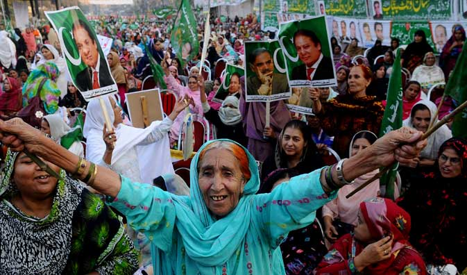 Supporters of Pakistan Muslim League-N (PML-N) attend a rally against Pakistan's President Asif Ali Zardari in Lahore on October 28, 2011.