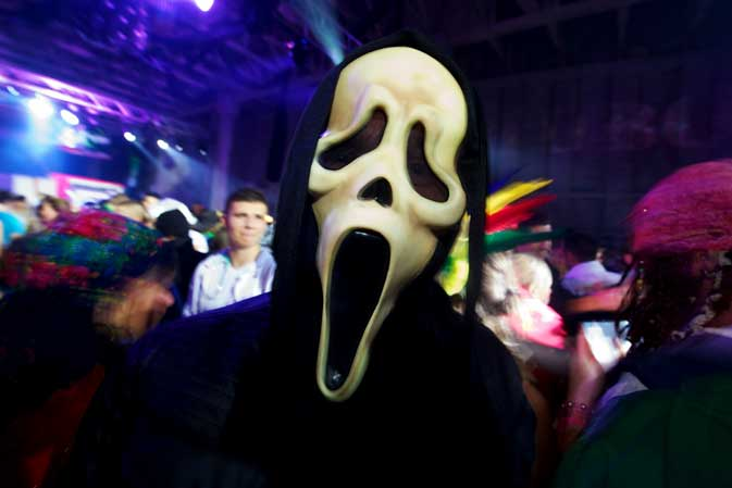 A man wearing Halloween costume poses during a Halloween Eve Party in Belgrade on October 30, 2011. Halloween is based on the Celtic festival of Samhain and the ancient Celts believed the border between this world and the otherworld became thin on that night, allowing spirits to pass through  ? AFP photo.
