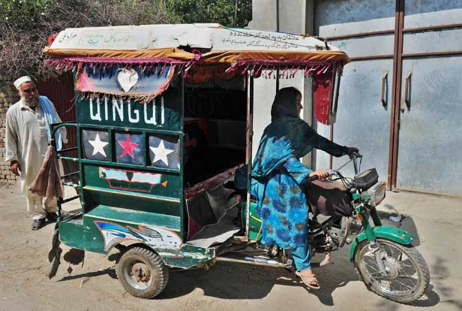 11-year-old Pakistani girl Wajiha drives a three-wheel rickshaw in Tangi, a town 125 kilometres from Islamabad, in the heart of the northwestern region troubled by a Taliban insurgency. Wajiha is the only girl driving a rickshaw to earn livelihood for her family.