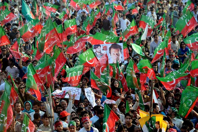 Supporters of Pakistani politician and former cricketer Imran Khan gather for a rally in Lahore on October 30, 2011.