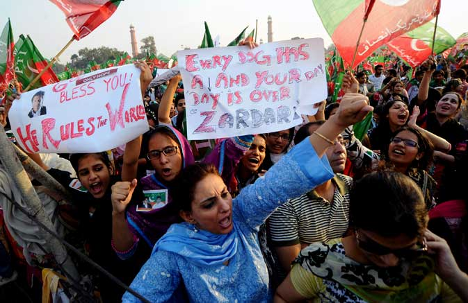 Supporters of Pakistani politician and former cricketer Imran Khan shout slogans during a rally in Lahore on October 30, 2011.
