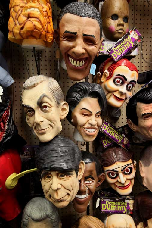 Masks of first lady Michelle and President Barack Obama, Chicago Mayor Rahm Emanuel, and former Illinois Governor Rod Blagojevich hang next to Demented Dummy masks at Fantasy Costumes on October 28, 2011 in Chicago, Illinois. The store, which had long lines at the registers at 4 AM this morning, is open around the clock through Halloween to help keep up with customer demand. Retailers nationwide are expecting record sales for Halloween merchandise this year with shoppers spending close to $7 billion dollars to cele