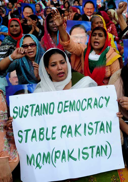 Activists of Muttahida Qaumi Movement (MQM) shout slogans during a rally in Karachi on October 30, 2011, in a show of support for president Asif Ali Zardari. Thousands gathered October 30 for a demonstration in Karachi in a show of support following derogatory remarks used by PML (N) leaders against the embattled president, while scores of others in Labore gathered for a rally called by cricket hero turned politician Imran Khan to press Zardari to step down.