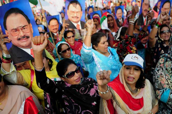 Activists of Muttahida Qaumi Movement (MQM) shout slogans during a rally in Karachi on October 30, 2011.