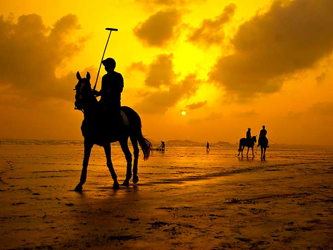 The players, the horses and the caretakers retire for the day as the golden sun descends downwards and sets in the Arabian sea.