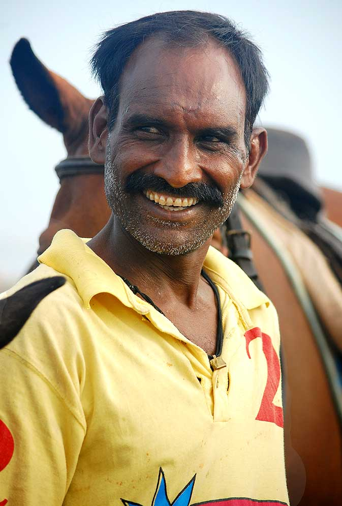 The story is about many stories. He is one of the caretakers of the horses. Responsible for bringing the horses to the beach everyday. His story is a part of the bigger polo story.