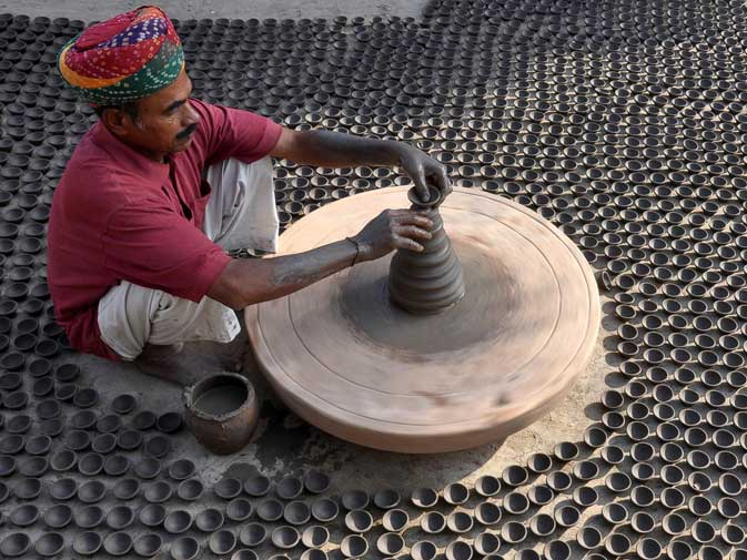 A potter makes earthen lamps ahead of the Hindu Diwali festival in Jodhpur on October 12, 2011. ? AFP