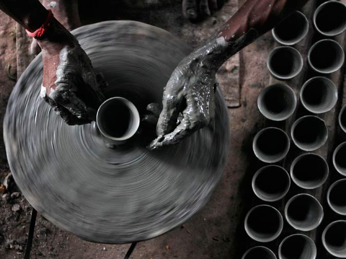 A potter makes an earthen lamp at a workshop for the upcoming Diwali festival in Kolkata. ? Reuters