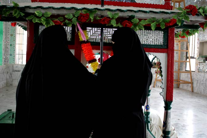 Sisters offering prayers at the shrine of Pir Haji Syed Sakhi Sultan.