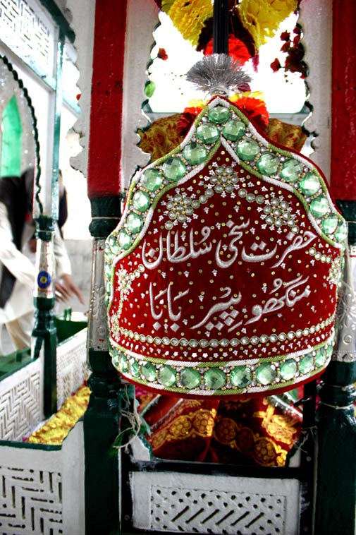 An Islamic version of a bandana, beaded and designed especially to be placed on top of the shrine of Sufi Pir Haji Sakhi Sultan.