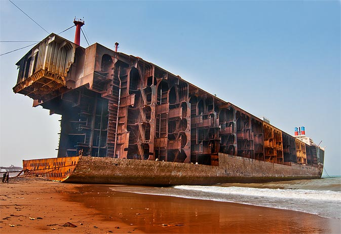 A hulking oil tanker stands with its bow removed on Gadani beach.