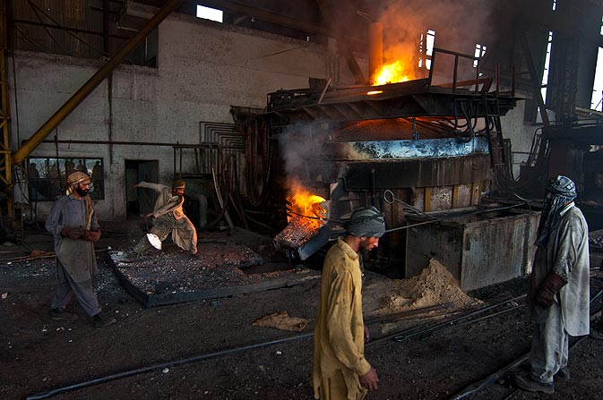 A continuous casting furnace is fueled by a worker in a billet making factory. The factory uses scrap metal and turns them into billets. The furnace needs to be heated to 1700 C in order to melt the steel.