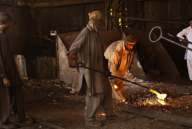 The workers also add other elements to the steel to give it different properties. Here they are adding manganese to increase the magnesium content of the billets produced.