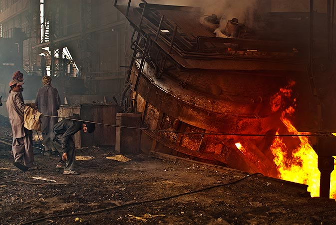 The molten steel being poured into moulds where it will be cooled into billet form.