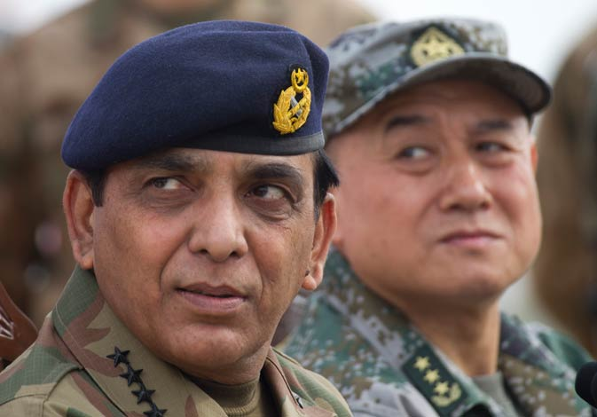 Pakistan army Chief Gen. Ashfaq Parvez Kayani, (left), listens to a reporter during a joint press conference with General Hou Shusen, Deputy Chief of the People's Liberation Army, China, at the conclusion of a joint. ? AP Photo.