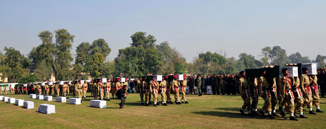 Pakistani soldiers carry the coffins of their comrades who were killed in a Nato strike during a funeral ceremony in Peshawar on November 27, 2011. ? AFP Photo