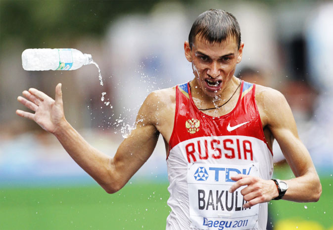 Sergey Bakulin of Russia tosses a bottle of water during the men's 50 km race walk final at the IAAF World Athletics Championships in Daegu September 3, 2011.