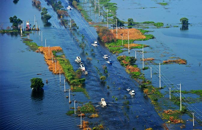 This aerial picture shows vehicles travelling on a flooded highway in a suburb of Bangkok on November 19, 2011.- AFP Photo