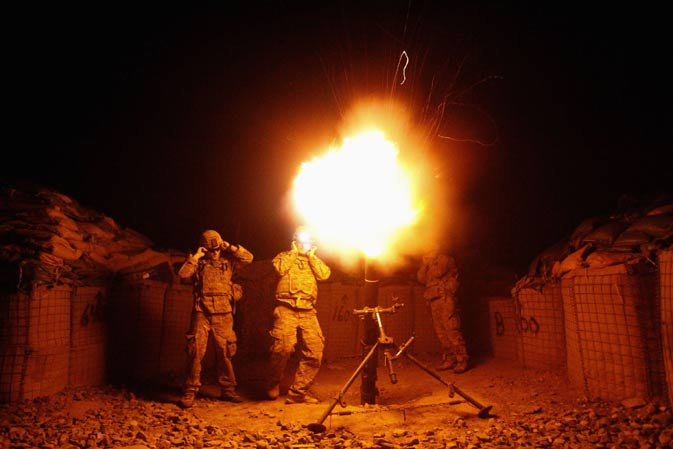 "U.S. soldiers from Task Force ""No Fear"", Alpha Company, 2-27 Infantry ""The Wolfhounds"", fire a 120mm mortar at a Taliban position from Combat Outpost (COP) Pirtle King in Ghaziabad district, Kunar province, eastern Afghanistan September 26, 2011."