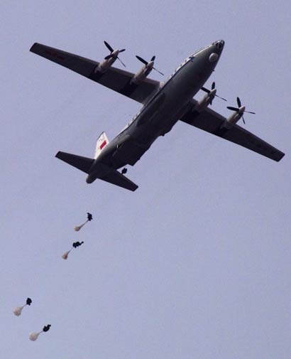 Chinese paratroopers jump from a Chinese Y-8.-AP Photo