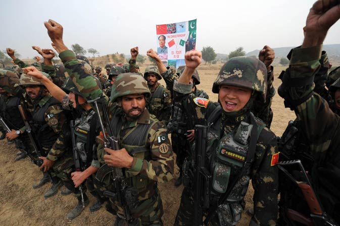 Chinese People's Liberation Army (PLA) soldiers and Pakistani commandos from the Special Service Group (SSG) shout ?Long live China, long live Pakistan? as they wrap up their two-week military exercise. ? AFP Photo.