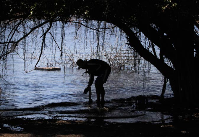 A man stands in a flooded area in Ayutthaya province November 22, 2011.- Reuters Photo