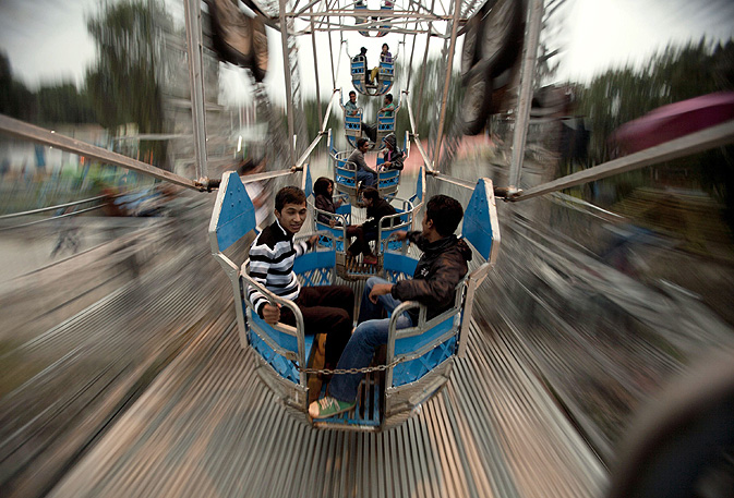 Nepalese youth enjoy a ride at the Ramailo Mela (Fun Park) amusement park in Kathmandu.
