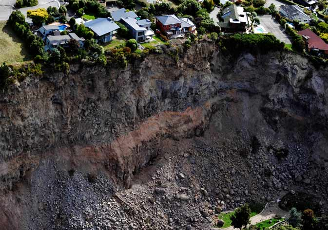Luxury houses teeter on the edge after landslides in Redcliffs near Christchurch on February 27, 2011, after a 6.3 earthquake devastated New Zealand's second city and surrounding towns on February 22. The quake caused more damage than the 7.1 magnitude quake that hit the city on September 4, 2010 and has killed at least 146 people
