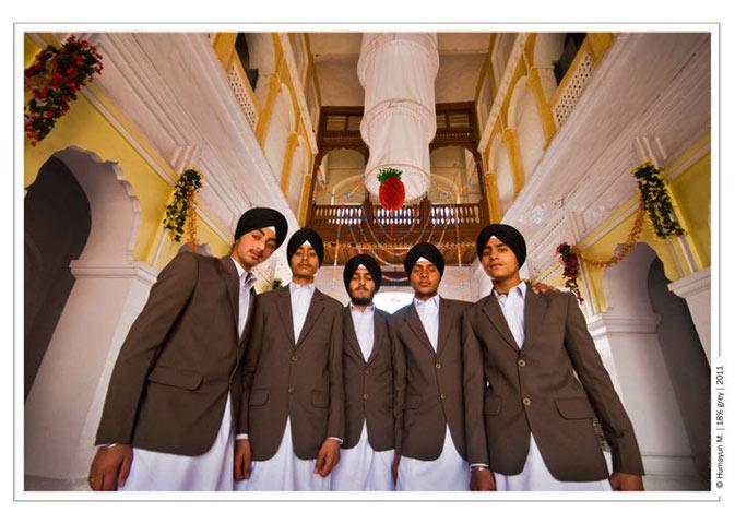 Sikh pilgrims pose for the camera- Photo by Humayun Memon | 18% grey