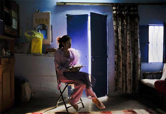 Memoona, 23, a survivor of an acid attack, poses for a photograph inside her residence in Karachi December 14, 2011. Memoona says the acid attack took place on August 13, 2002, when a boy threw acid on her face and body over an old family feud. Memoona, who is currently enrolled in nursing school, said she lost her eye but not her spirit. The Pakistan Senate unanimously passed the Acid Control and Acid Crime Prevention Bill on December 12, recommending a 14-year to lifetime imprisonment sentences and levies fines u