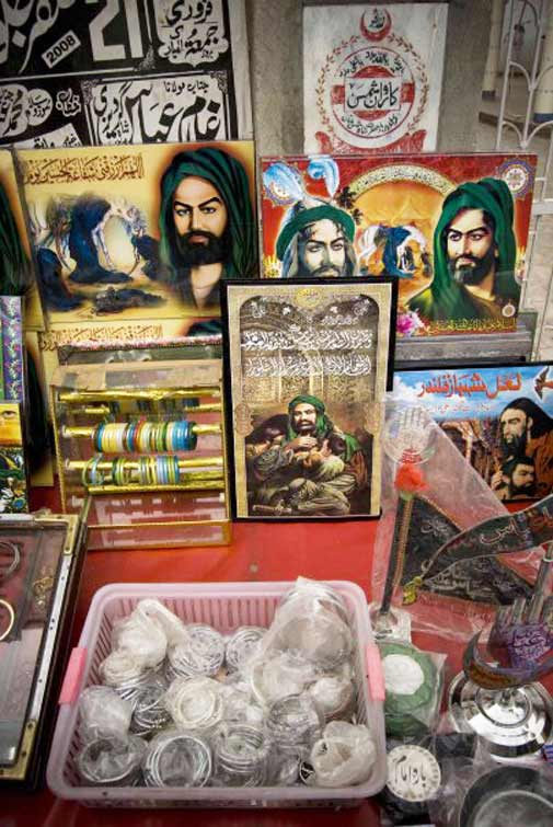 A stall outside a shrine selling religious memorabilia - Photo by Humayun M | 18% grey