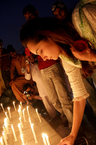 Aamna, a university student and primary school teacher, lights a candle. ?We can?t just sit at home and watch the news telling us more of our people got killed again by Nato. It's time we come out on the streets and record our protests.?