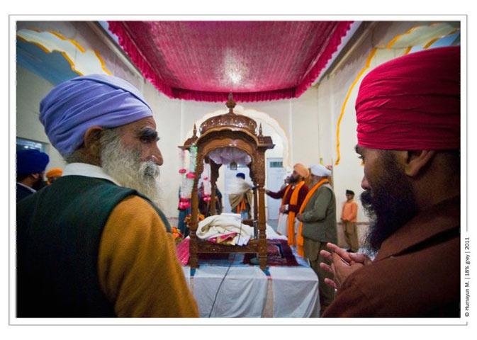 Sikhs praying- Photo by Humayun Memon | 18% grey
