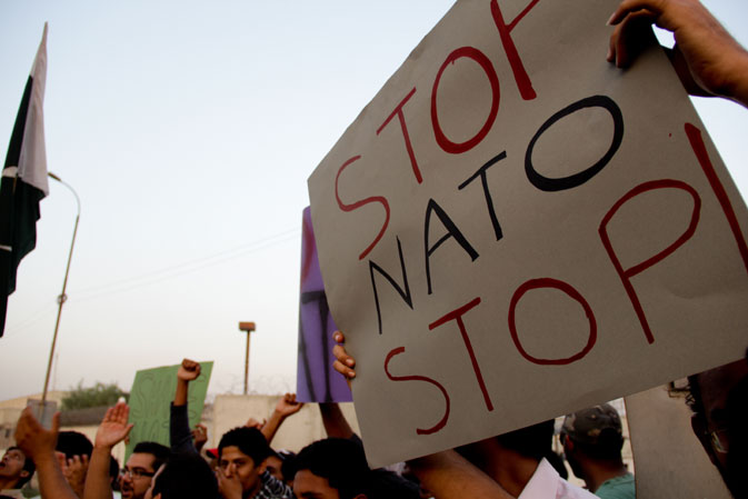 The protestors organise themselves on the road outside the fortified US consulate building before they begin to march.