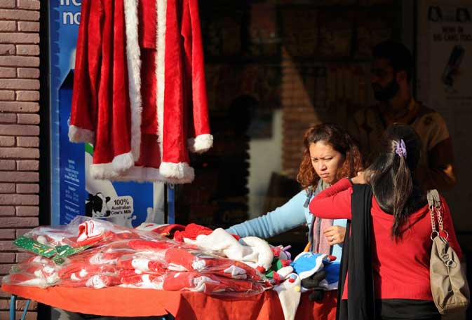 Women shop for Christmas-related items at a market in Islamabad on December 15, 2011.